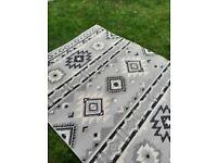 Large woven indoor outdoor rug