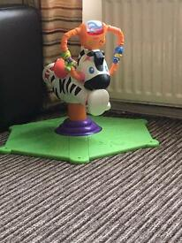 Bounce and spin fisher price zebra