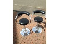 Two back and chrome bar stools