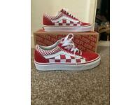 Red checkerboard laced vans
