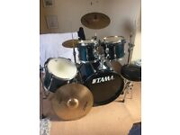 Tama rockstar fusion kit with cymbals and stands.
