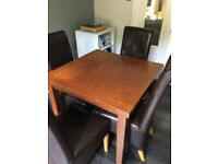 Extending Dining Table and 4 Leather Chairs