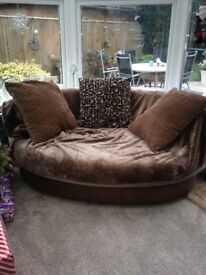Large brown snuggle chair