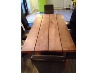 solid pine table with 8 large chairs