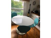 White round dining table + 3 chairs