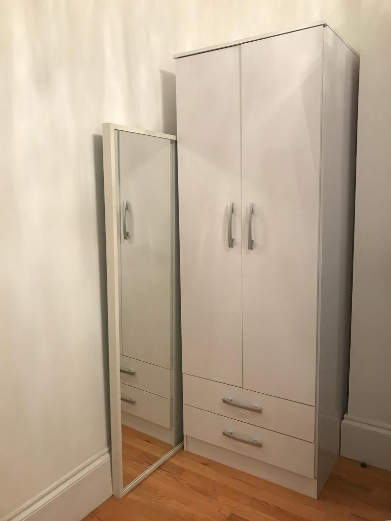 Tall double door wardrobe with two drawers. Must go by Friday