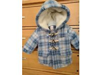 Baby coat 3-6 months, bluezoo, lovely thick warm, faux sheepskin. Worn once. Gorgeous condition.