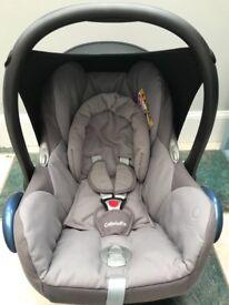 Maxi cosi cabriofix car seat with isofix base.