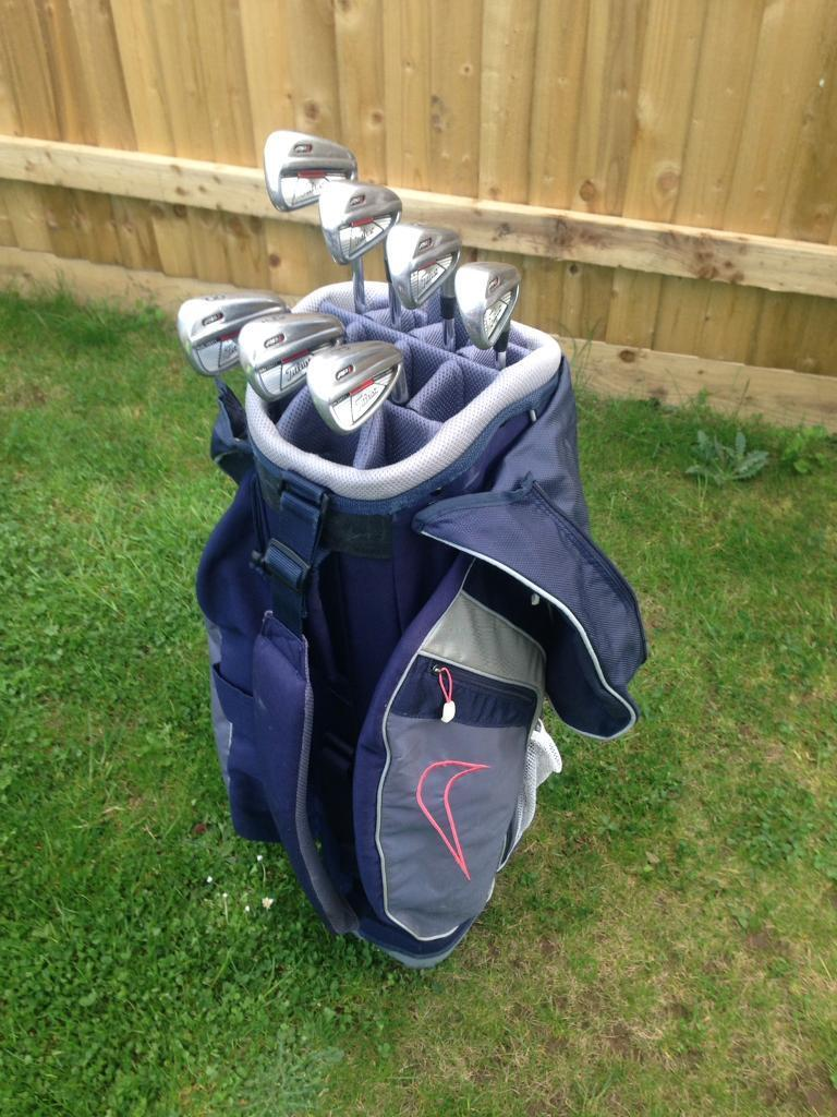 Titleist ap1 irons and Nike bag