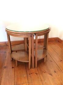 Circular table with nest of 4 tables
