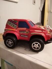 grey/red 4 wheel car toy push and let go
