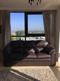 Free chocolate brown faux leather sofa