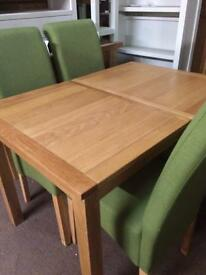Solid oak table £180 chairs any colour £50 each