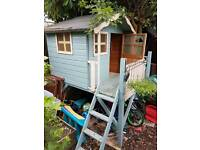 Kids Wooden Playhouse on legs with slide and steps