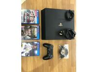 PlayStation PS4 pro with 3 games and 1 controller.