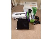 Xbox 360 (250Gb) with kinect, 2 wireless controllers and 8 games.