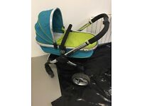 Icandy peach double pram with carry cot, rain covers, umbrella and foot muff