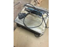 240v electric tile cutter, used but cheap, extras, Harrow collection.