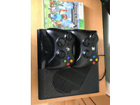 Good condition Xbox 360 E 500GB console with two wireless controllers plus Minecraft game