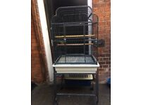 Bird cage approx 5ft tall . Good / used condition. . Big enough for parrots. Pick up only .
