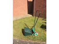 Qualcast Push Along lawn mower.