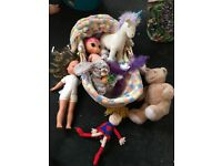 Moses basket and dolls