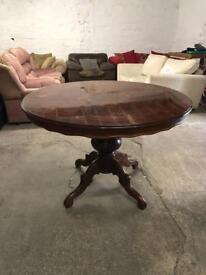 Round wooden Italian table