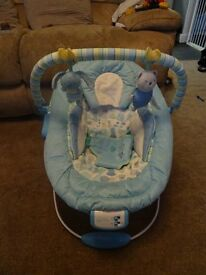 Blue baby bouncing chair with toys - vibrates and play music