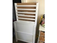 white cotbed