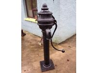 antique cow tail pump