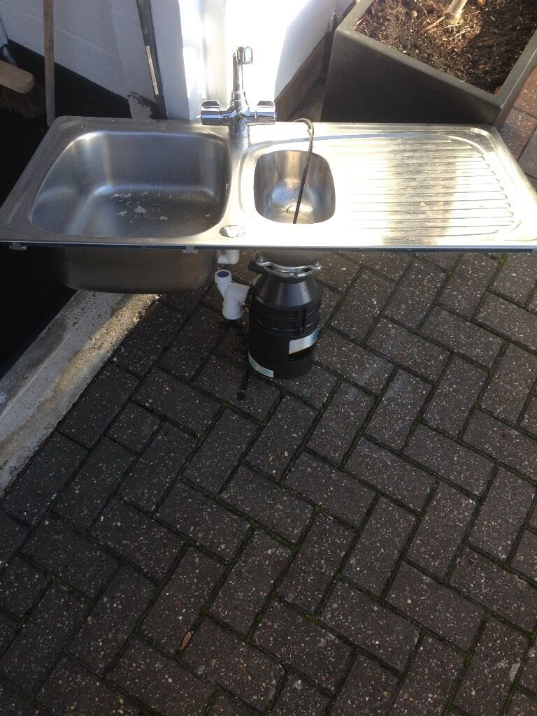Stainless steel sink, taps and food waste disposal