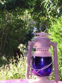 Blue lantern oil-lamp for home or barn.