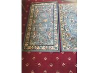2 blue rugs woven backed