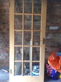 Solid oak glass panelled door