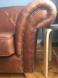 Tan real leather sofa from Laura Ashley