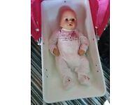 baby annabelle doll an pram