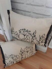 Two oatmeal cushions