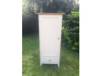 White wooden child's wardrobe