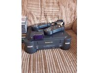 "Panasonic ""Real"" 3DO console with games and wireless controllers."