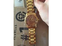 Gold coloured watch