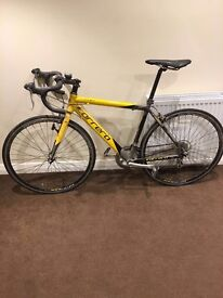 Bkack and yellow mens Carrera road road bike, hardly used, speedometer fitted,