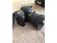 Nikon d7000 SLR 3x lens and flash 2x16gb card bags and instructions