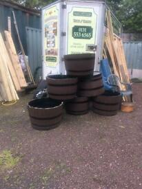 Half painted planters whisky barrels