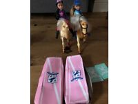 Two toy ponies with riders ( one battery operated pony that moves and makes a horse sound )