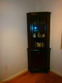 Stag Furniture Tall display corner unit.