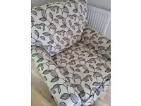 Comfortable, individual armchair with cream and black loose covers in quality fabric