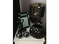 Black living room accessories - lamps, photo frames, ornaments
