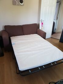 Two 2 seater sofa beds including cushions.