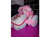 babys nappy trikes £23 each also nappy cake in lemon £30