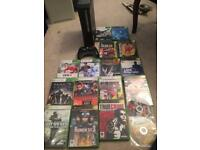 Black Xbox 360 elite console and games